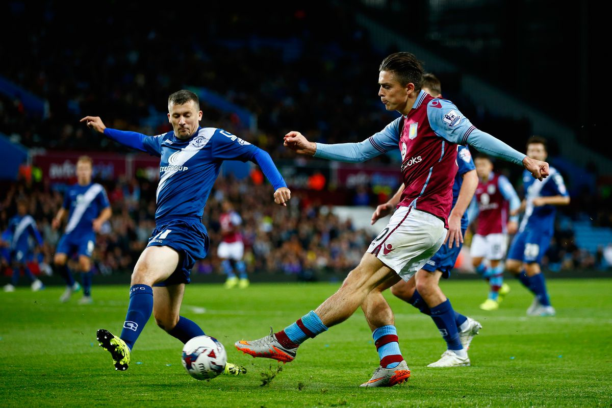 Jack Grealish of Aston Villa crosses the ball during the Capital One Cup third round match between Aston Villa and Birmingham City at Villa Park on September 22, 2015 in Birmingham, England.