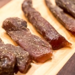 Rabbit loin is compressed, cured in a mixture of fennel seed and salt, and then hung to dry for a week or two.