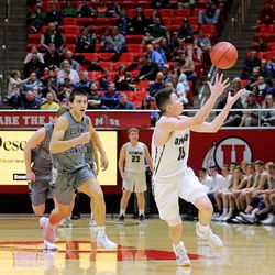 Olympus' Rylan Jones catches an over-the-shoulder pass ahead of Corner Canyon's John Mitchell as they play in the 5A basketball championship in the Jon M. Huntsman Center at the University of Utah on Saturday, March 3, 2018.