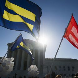 Equality flags fly in front of the Supreme Court in Washington, Tuesday, April 28, 2015. The Supreme Court heard historic arguments in cases that could make same-sex marriage the law of the land.
