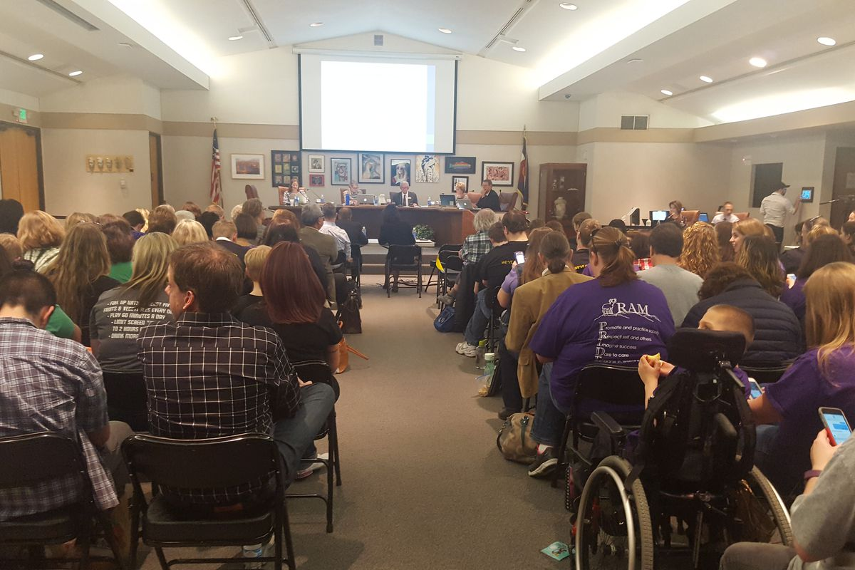 The Jeffco Public Schools board room is packed on Thursday for a discussion on school closures.
