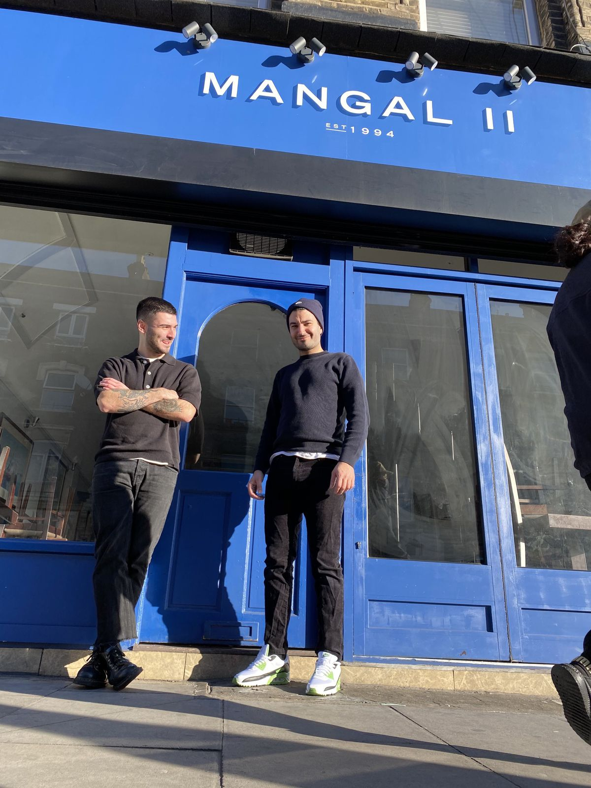 Brothers Sertaç and Ferhat Dirik, owners of Mangal 2 outside the restaurant in Dalston