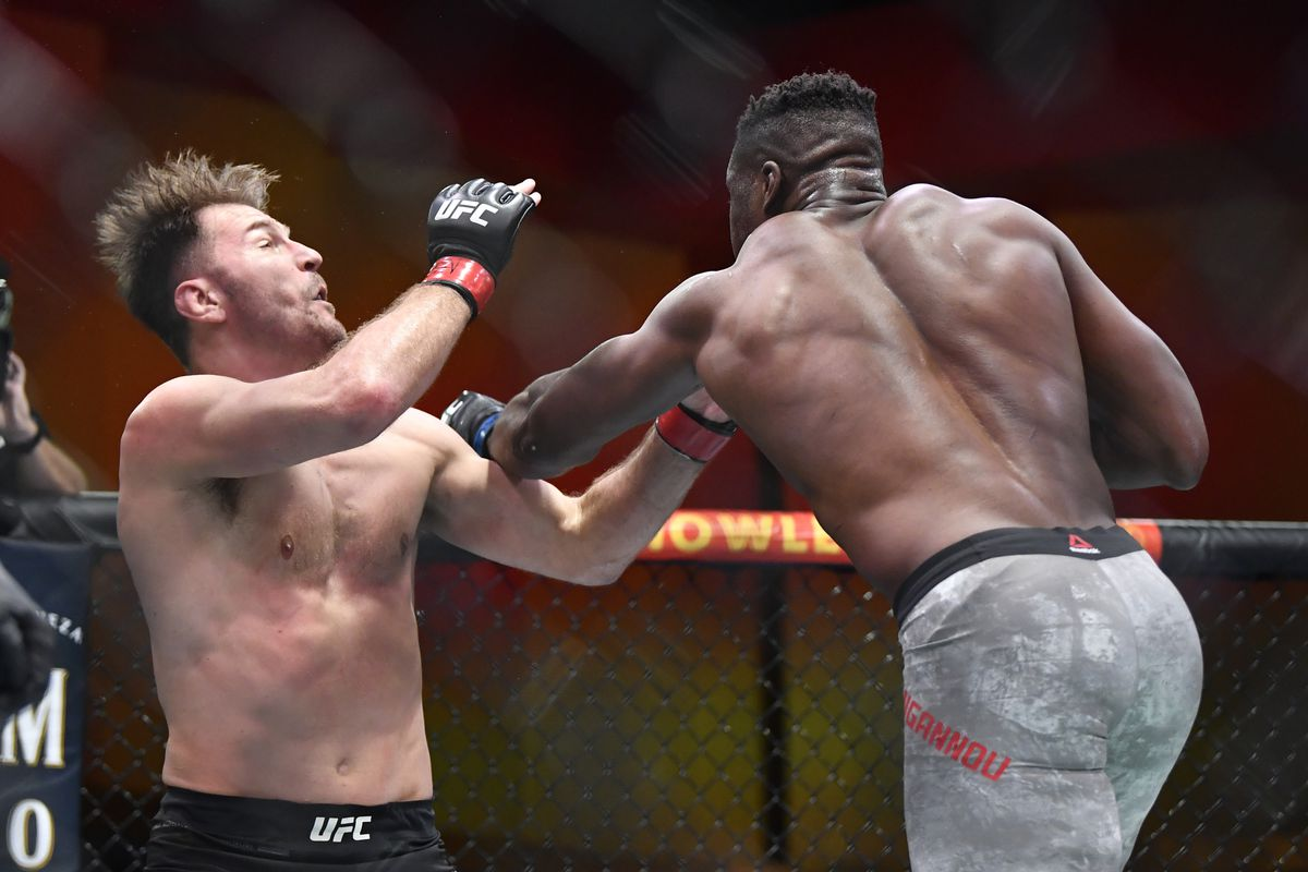Francis Ngannou lands a left hook to the jaw of Stipe Miocic in the main event of UFC 260.