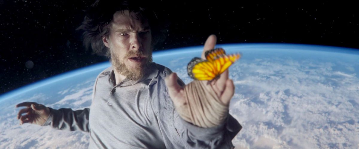 doctor strange floats above the earth touching a butterfly