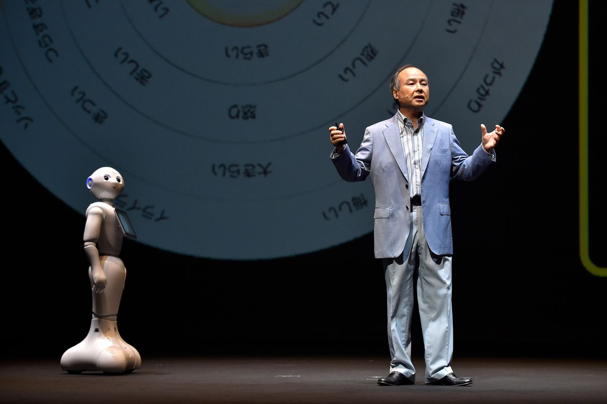 Pepper the robot and Masayoshi Son, chairman and chief executive officer of SoftBank, onstage.