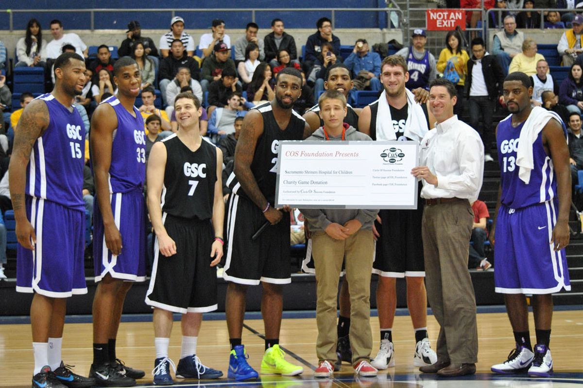 DeMarcus Cousins, Hassan Whiteside, Jimmer Fredette, Donté Greene, Jason Thompson, Spencer Hawes and Tyreke Evans pose for a photo op at halftime of the Goon Squad Classic. (Photo: James Ham/Cowbell Kingdom)