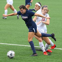 UConn's Cara Jordan #26 gets fouled during the UMass Minutewomen vs the UConn Huskies at Morrone Stadium at Rizza Performance Center in an exhibition women's college soccer game in Storrs, CT, Monday, August 9, 2021.