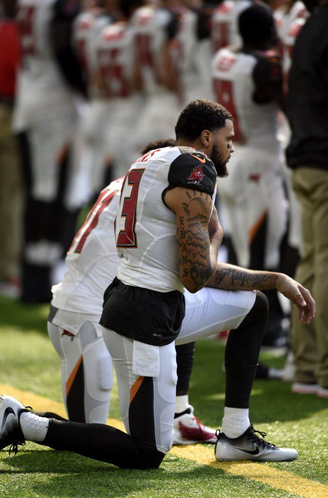 MINNEAPOLIS, MN – SEPTEMBER 24: Tampa Bay Buccaneers Wide Receivers Mike Evans #13, and DeSean Jackson #11, take a knee during the national anthem before the game against the Minnesota Vikings on September 24, 2017 at U.S. Bank Stadium in Minneapolis, Min
