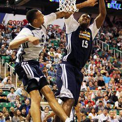 Rudy Gobert fouls Derrick Favors as the Utah Jazz scrimmage in Salt Lake City, Saturday, Oct. 5, 2013.