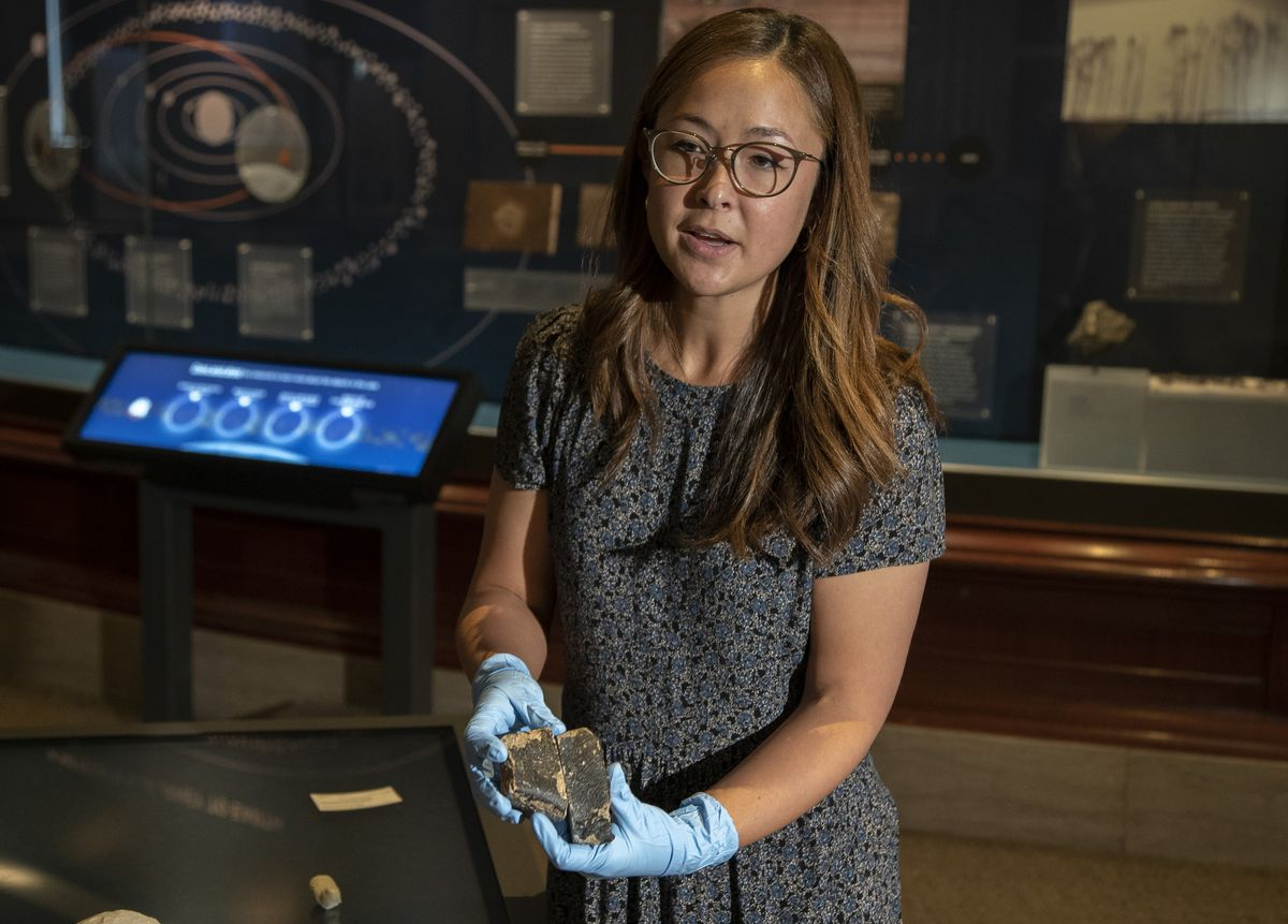 Maria Valdes, the Field Museum's Meeker postdoctoral researcher, holds the samples of the meteorite on Wednesday.