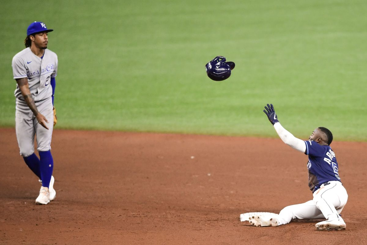 Adalberto Mondesi #27 of the Kansas City Royals throws Randy Arozarena #56 of the Tampa Bay Rays his helmet after being caught stealing second base during the fifth inning against the Kansas City Royals at Tropicana Field on May 26, 2021 in St Petersburg, Florida.