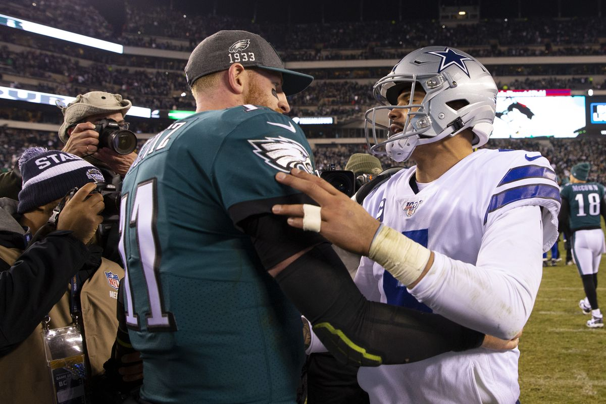 Carson Wentz of the Philadelphia Eagles and Dak Prescott of the Dallas Cowboys embrace after the game at Lincoln Financial Field on December 22, 2019 in Philadelphia, Pennsylvania.