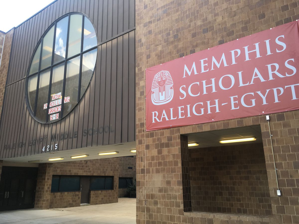 The new sign for Memphis Scholars Raleigh-Egypt is hung near the faded letters of the school's former middle school name under Shelby County Schools.