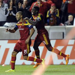 Real Salt Lake forward Alvaro Saborio (15) is congratulated by Real Salt Lake forward Olmes Garcia (13) following his second goal of the game during a game at Rio Tinto Stadium in Sandy on Saturday, March 29, 2014.