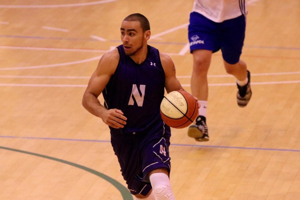 Tre Demps dribbling up the court during NU's 85-63 win over CB Tarragona on Saturday.