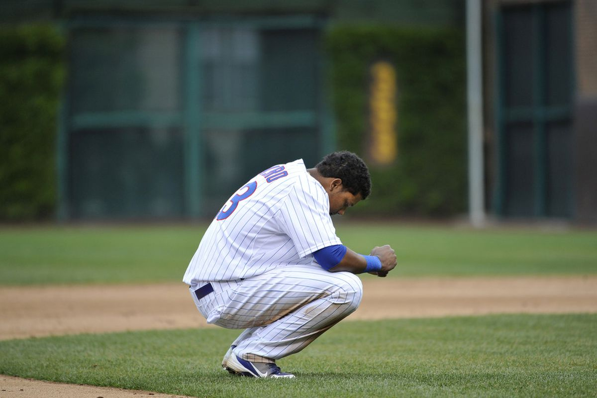 Yeah, Starlin, we know how you feel: Starlin Castro of the Chicago Cubs squats on the infield grass after the sixth inning against the Los Angeles Dodgers at Wrigley Field on May 5, 2012 in Chicago, Illinois.  (Photo by Brian Kersey/Getty Images)
