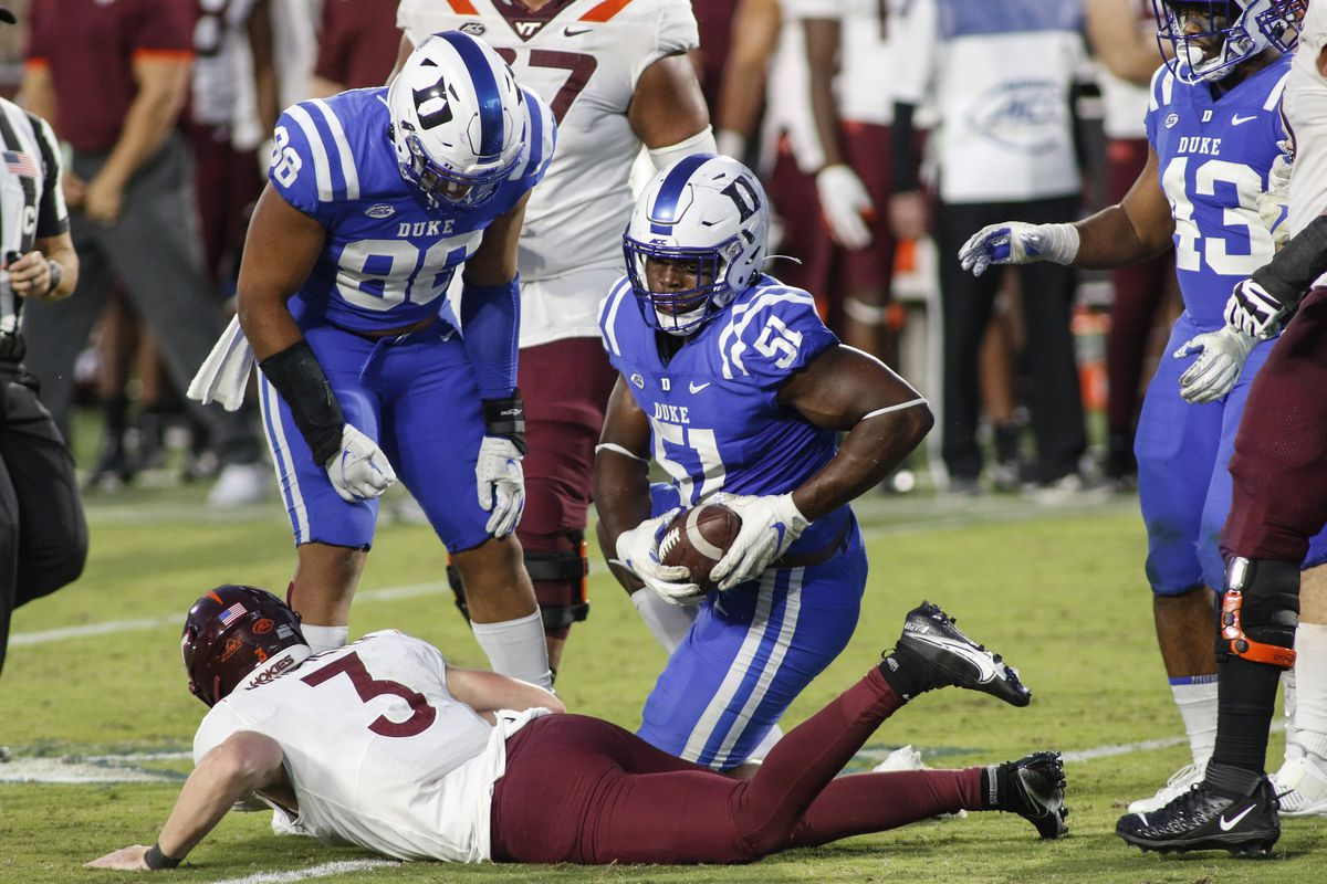 Duke Blue Devils defensive end Victor Dimukeje recovers a fumble by Virginia Tech Hokies quarterback Braxton Burmeister in the second half at Wallace Wade Stadium.