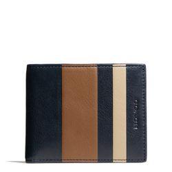"<a href=""http://f.curbed.cc/f/Coach_SP_121113_IDwallet"">Bleecker slim billfold ID wallet in debossed striped leather</a>, $138"