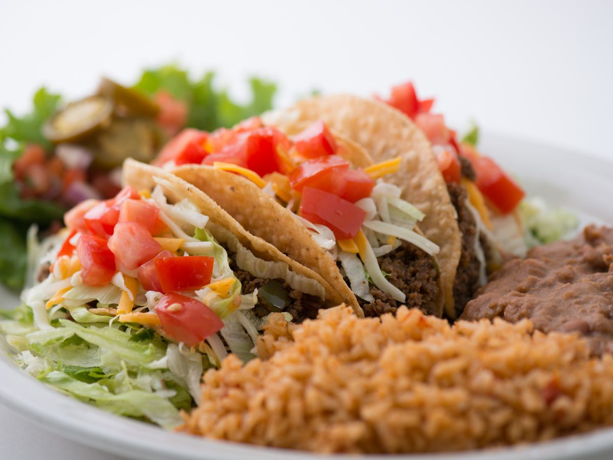 Tacos, rice and beans on a plate at Chuy's in Miami.