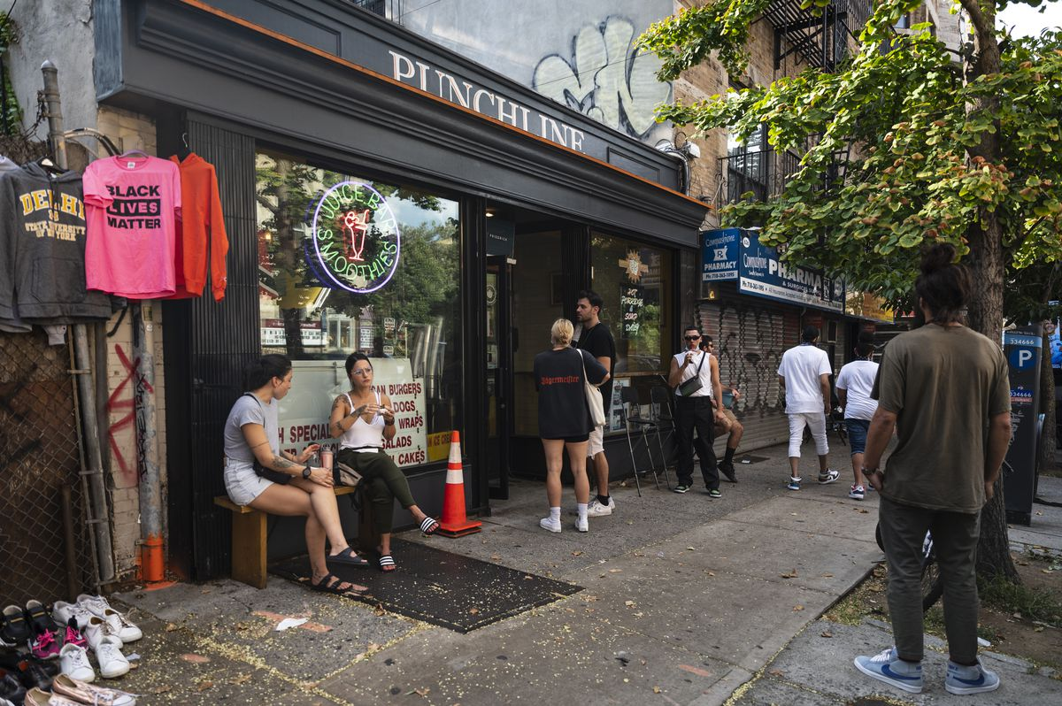 Brooklynites gather outside of a juice bar in Crown Heights.
