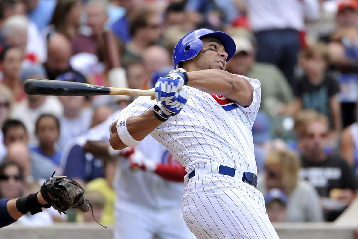 CHICAGO, IL - AUGUST 20:  Carlos Pena #22 of the Chicago Cubs follows through on a triple during the fourth inning against the St. Louis Cardinals at Wrigley Field on August 20, 2011 in Chicago, Illinois.  (Photo by Brian Kersey/Getty Images)