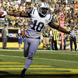 New York Jets wide receiver Santonio Holmes (10) celebrates as he runs through the end zone after catching a pass for touchdown in the first quarter of an NFL football game against the Pittsburgh Steelers in Pittsburgh, Sunday, Sept. 16, 2012.