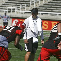 Utah head football coach Kyle Whittingham watches as his players run drills during practice Monday.
