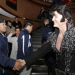 BYU defensive lineman Mosese Foketi shakes hands Wednesday with Elvis at the ESPN Zone Welcome Reception at the New York New York Hotel in Las Vegas. The reception was for BYU and Arizona teams and they enjoyed arcade games, food and activities.