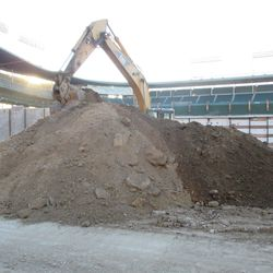 A reverse view of the tall mound of dirt on Sheffield, almost blocking out the digging equipment behind it