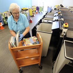 Patti Rogers, assistant librarian at the Springville Library in Springville, sorts books that are being returned and need to be quarantined on Wednesday, April 8, 2020. Books stay in the quarantine room for at least 72 hours before they can be borrowed again.