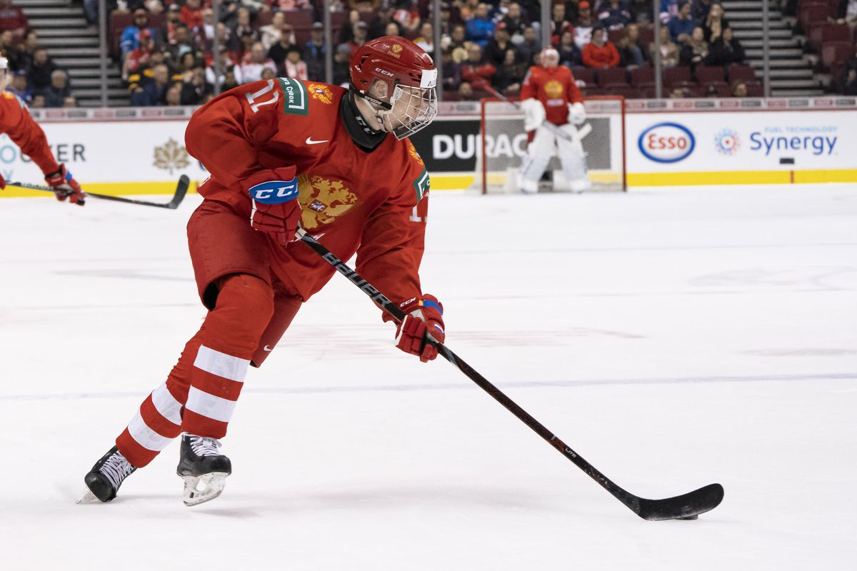VANCOUVER, BC - JANUARY 5: Vasili Podkolzin #11 of Russia skates with the puck in the Bronze Medal game of the 2019 IIHF World Junior Championship against Switzerland on January, 5, 2019 at Rogers Arena in Vancouver, British Columbia, Canada.