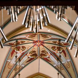 The ceiling of the Cathedral of the Madeleine is seen behind organ pipes on Tuesday, May 12, 2020.
