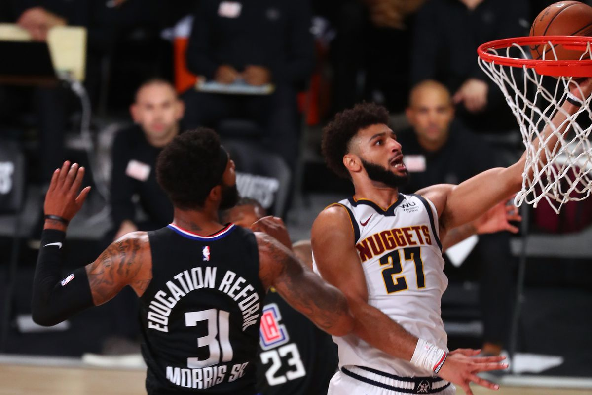 Denver Nuggets guard Jamal Murray shoots past Los Angeles Clippers forward Marcus Morris Sr. during the first half in game seven of the second round of the 2020 NBA Playoffs at ESPN Wide World of Sports Complex.