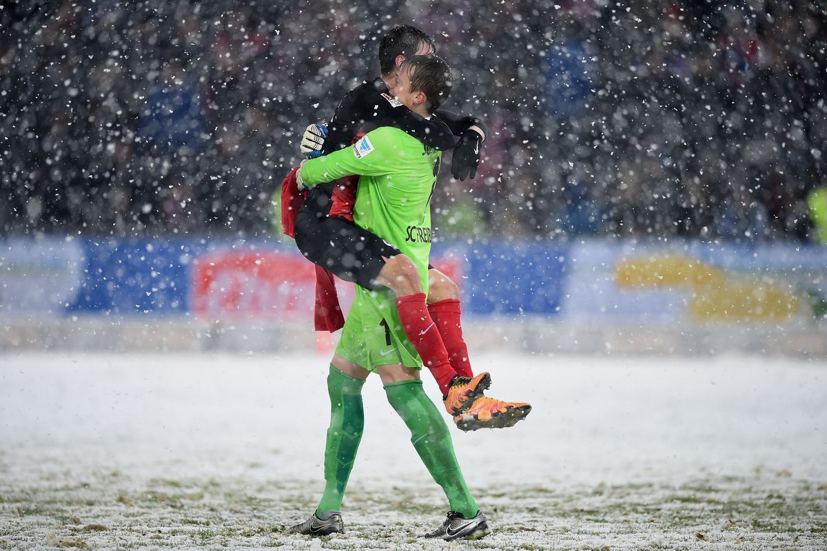 Pascal Stenzel leaps into the arms of Freiburg keeper Alex Schwolow after a win over Red Bull Leipzig.
