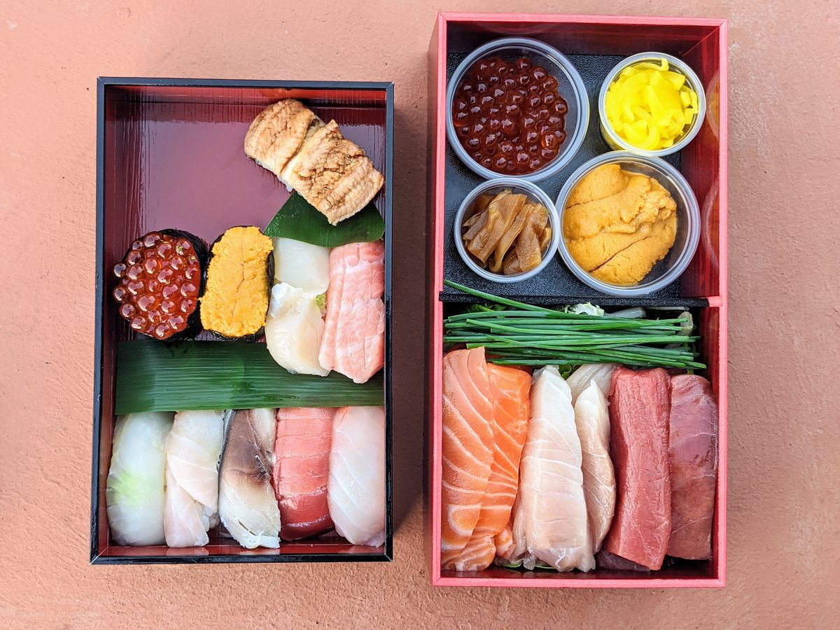 A collection of fresh sushi and nigiri in a simple box.