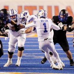 BYU quarterback Zach Wilson (1) has his foot stepped on and goes down on a fourth down play as BYU and Boise State play a college football game at Albertsons Stadium in Boise on Friday, Nov. 6, 2020.