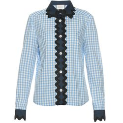 A new spin on the classic blue gingham button-down. This one by Gucci has a denim collar, panel, and cuffs.