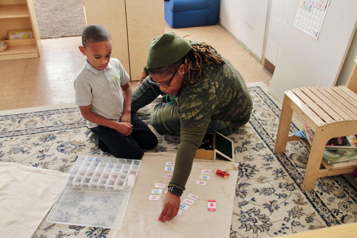 A Libertas teacher works with a student.