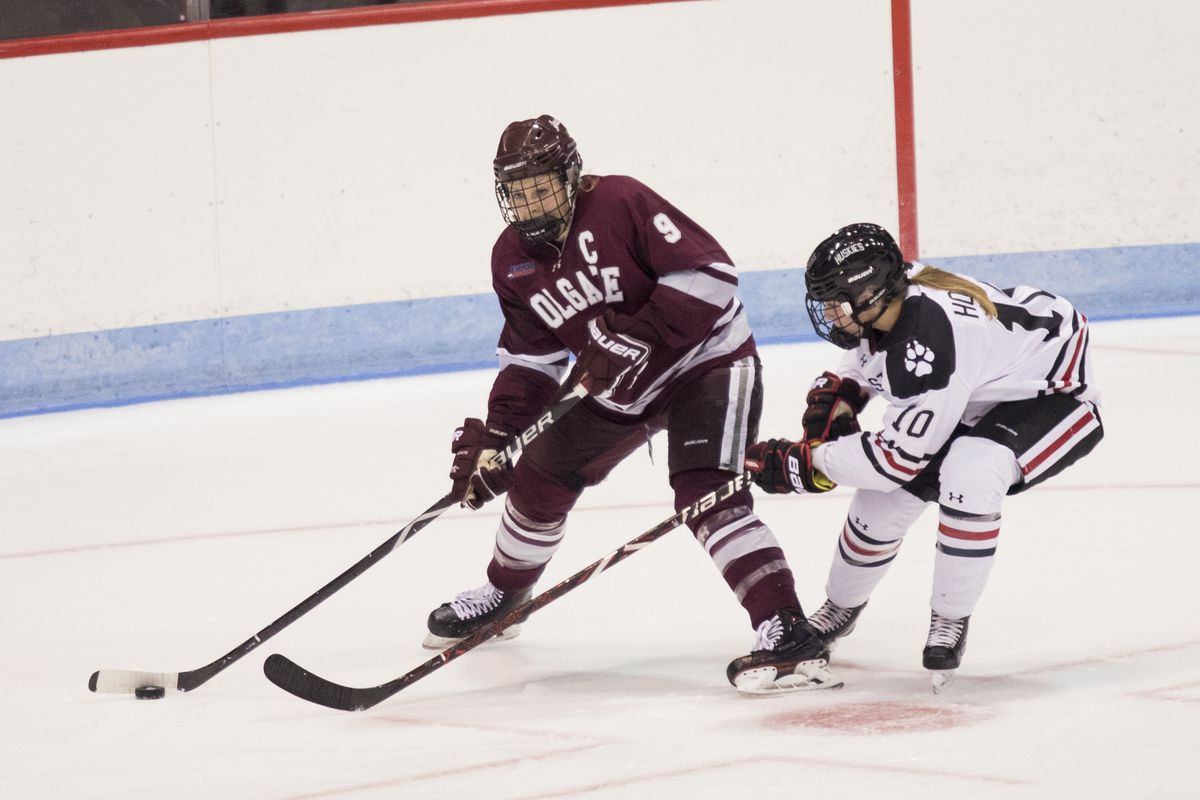 Northeastern defender Brooke Hobson defends Colgate forward Jessie Eldridge during an NCAA game at Matthews Arena in Boston, MA on Oct. 12, 2018. (Photo by Michelle Jay)