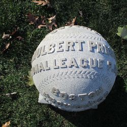 The baseball marker, the raised lettering and stitching was once blackened, but that has almost completely worn away