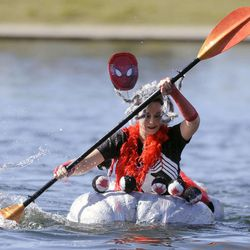 Aubrey Kruisman competes in the 2013 Mountain Valley Seed Co. Ginormous Pumpkin Regatta at Sugarhouse Park on Saturday, October 19, 2013.