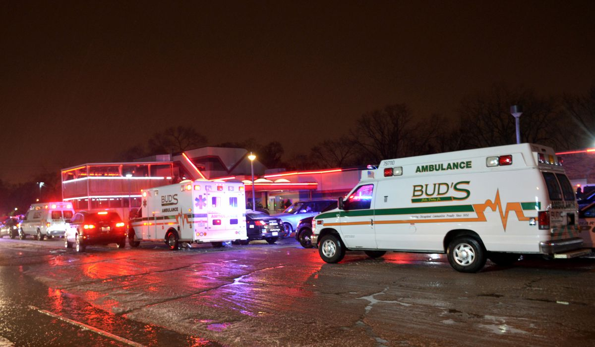 Emergency crews respond to a shooting early Saturday that left four men wounded at a strip club in south suburban Harvey. | Justin Jackson/Sun-Times