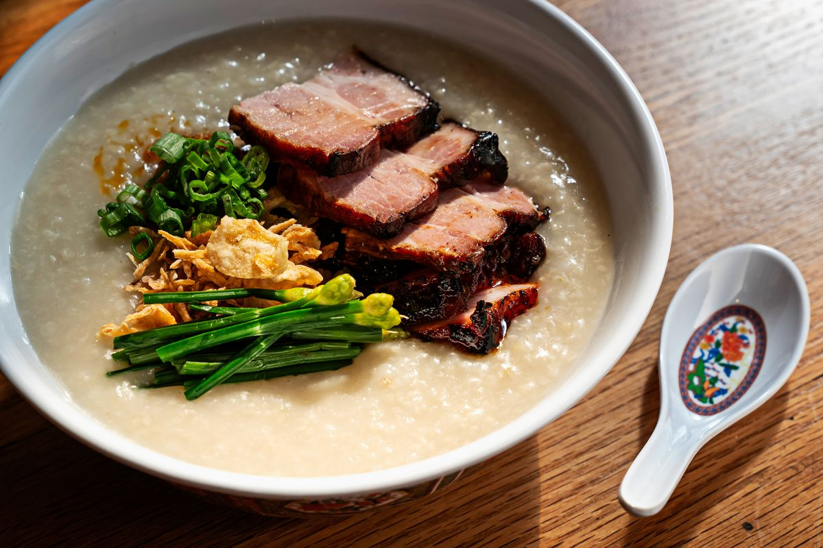 A bowl of char siu, congee, and vegetables from Hei Hei Tiger