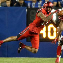 Utah Utes wide receiver Raelon Singleton (11) pulls in a pass during the game against the Brigham Young Cougars at LaVell Edwards Stadium in Provo on Saturday, Sept. 9, 2017.
