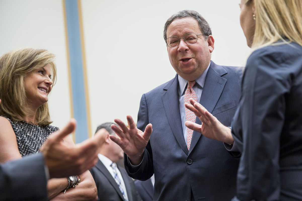 David L. Cohen, Executive Vice President of Comcast, talks with aides prior to the start of a House Judiciary Committee hearing on the proposed merger of Time Warner Cable and Comcast, on Capitol Hill, May 8, 2014 in Washington, DC.