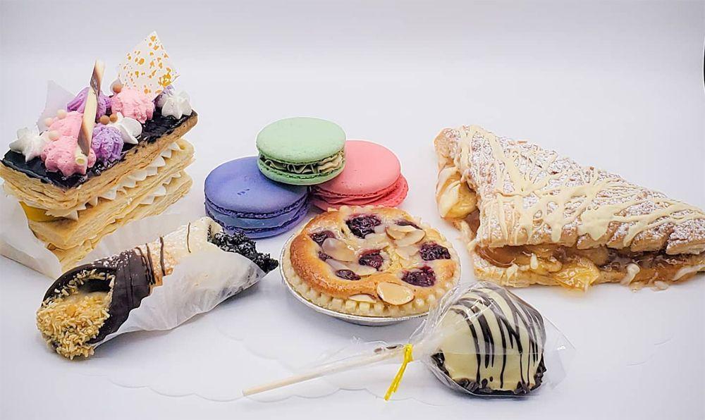 Jo's Malasadas Cafe & Bakery's sampler box featuring eight individual pastries.