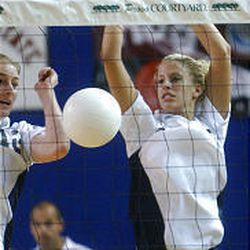 BYU's Kimberly Wilson, right, and Catherine Parker block a spike in Game 3 vs. Penn State.