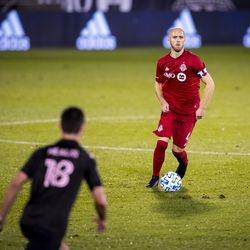 Captain Michael Bradley #4 of Toronto FC sports a giant Bank of Montreal logo on his chest, but it doesn't seem to hurt his soccer abilities.