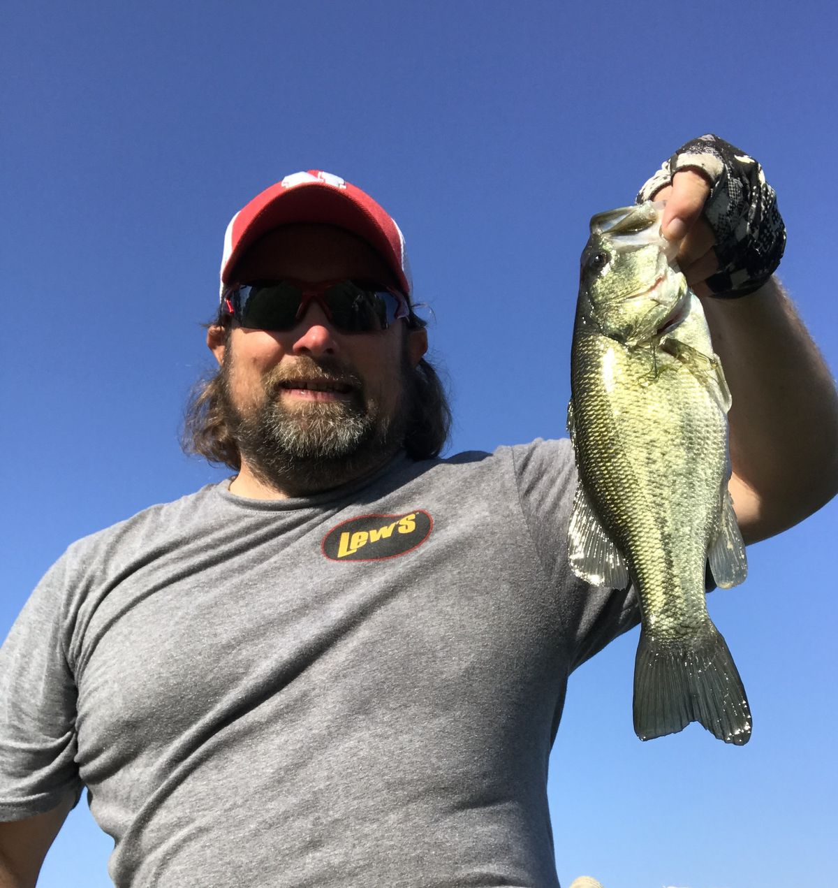 """Ken """"Husker"""" O'Malley and local largemouth bass. Provided photo"""