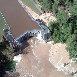 In this aerial photo provided by the Louisiana Coastal Protection and Restoration Authority, the lock on the Pearl River Diversion Canal has water rushing through the right side that officials fear will erode the land around it and compromise the structure. This fear prompted the evacuation of residents down river.